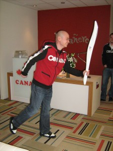 Sing with the Olympic Torch at the office.